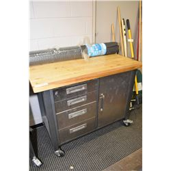 Mastercraft rolling work bench cabinet and a roll of floor mat