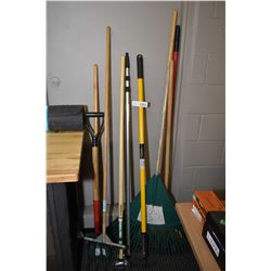 Selection of gardening tools including hoes, weeders, rakes etc.