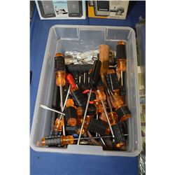 Plastic tote containing screwdrivers, screwdriver sets, combination wrenches etc.