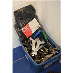 Small tub containing a large selection of used wrenches, screwdrivers etc.