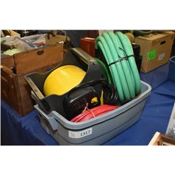 Tote containing garden hose, extension cord, cord spool etc.