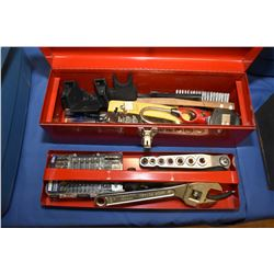 Small metal tool box containing predominately new tools including ratchet set, adjustable ratchet, s