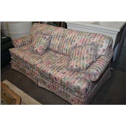 Two seat pastel floral hide-a-bed