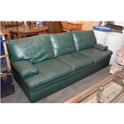 Full sized forest green leather sofa