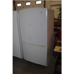 Woods fridge freezer with bottom freezer section