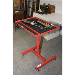 Rolling workshop cart and two grease guns
