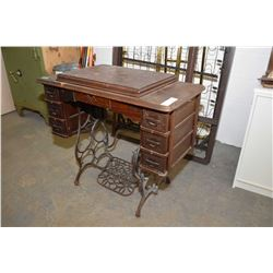 Antique oak and metal treadle sewing machine