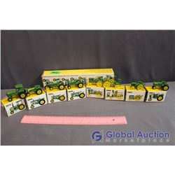 Set of (8) John Deere Miniature Metal Toy Tractors (all in Box)