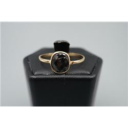 A 14K yellow gold inlaid with black diamond ring