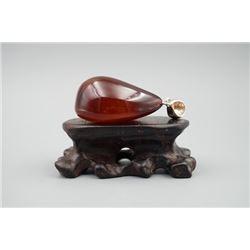 A baltic cherry amber pendant.