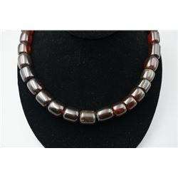 A blood cherry amber barrel beads necklace.