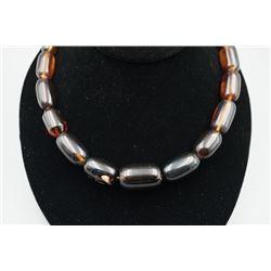 A blue amber barrel bead necklace.