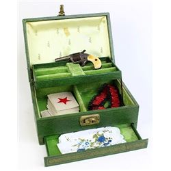 Green jewelry box includes garter, card deck,