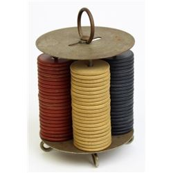 """Small vintage chip rack with chips, 5"""" tall."""