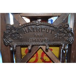 "Cast Iron Towel Holder -  ""Haircut and Shave 25c"""