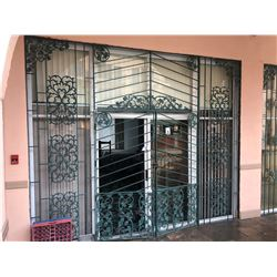 GREEN WROUGHT IRON STOREFRONT SECURITY GATES WITH FRAME