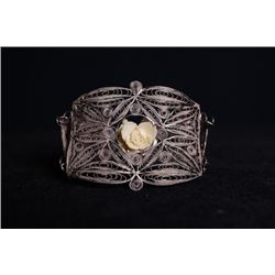 """A Filgree Bracelet Inlay with Ivory Carved """"Flora""""."""