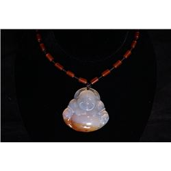 "A deep sea agate ""laughing Buddha"" pendant with beads necklace."