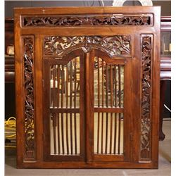An early 20th century wood carved mirror.