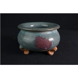 A Leopard-Glazed Tripod Incense Burner.
