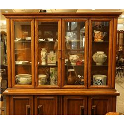 A glass display cabinet .