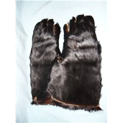 Bear hide gauntlets and Winchester marked saddle cinch