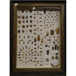 "138 artifacts, in 20"" x 26"" frame, arrowheads, scrapers, knives, buffalo teeth, rattle snake rattles"