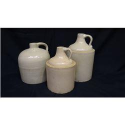2 crock jugs, 1 -round top 1 gal, 2 - 1/2 gal., some cracks