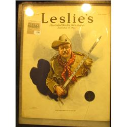 "12"" x 16"" glass (cracked) faced case containing a July 27th, 1916 Issue of ""Leslie's Illustrated New"
