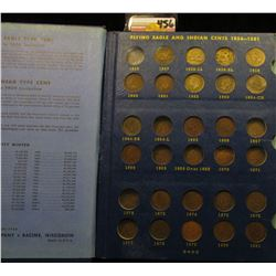 1857-1909 Partial Set of Indian Head Cents in a blue Whitman folder. Includes three Flying Eagle Cen