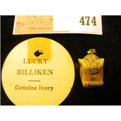 "Genuine ""Lucky Billiken Genuine Ivory"" with a small Gold Nugget belly button."