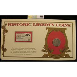 """1877 P Seated Liberty Quarter. Mounted in a """"History Liberty Coins"""" special holder with a """"Preamble"""