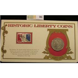 """1921 P Morgan Silver Dollar. Mounted in a """"History Liberty Coins"""" special holder with a """"Statue of L"""
