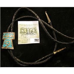 Western Style Bolo Tie with crushed Turquoise Indian Motif design in Sterling Silver.