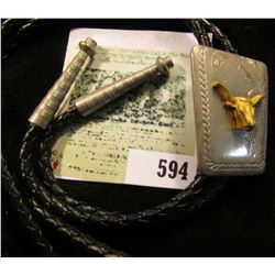 Western Style Bolo Tie with Golden Steer on engraved background.