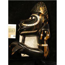 Canoe-prow figure, Soloman Islands, Melanesia, nineteenth to twentieth century. Wood with mother-of-