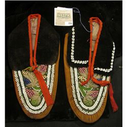 Pair of Beaded Leather and felt Moccasins. Doc valued at $580 in his collection.
