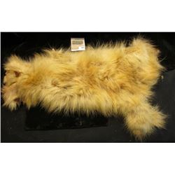 Either a Opossum or a Blonde Raccoon hide. Tanned and turned into leather with fur on. Ready for the