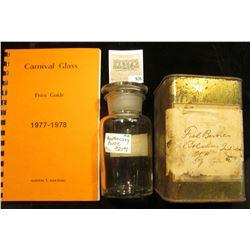 "5 1/4"" x 2 1/2"" Clear Glass Apothecary Jar labeled ""OL. CAJUPUTI"" (no contents); antique Medicine Ti"