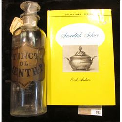 """9"""" x 2 5/8"""" Apothcary Jar with glass Stopper, no contents.  Labeled """"Tinct.OL: Menth: P:""""; & a hardb"""