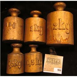 Five-piece Set of Heavy Brass Weights, which includes (2) 0.5 KG, (2) 1 Kg, & a 2 Kg. Stored in a li
