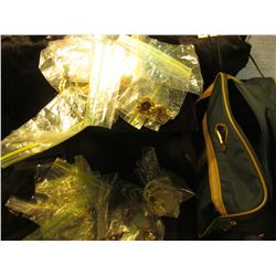 1034 _ Samsonite Carrypak with a large amount of Costume Jewelry, necklaces, broaches and etc.
