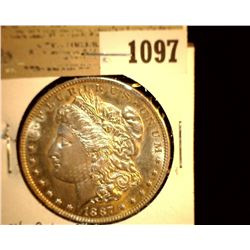 1097 _ 1887 P Morgan Silver Dollar, Choice BU 64.