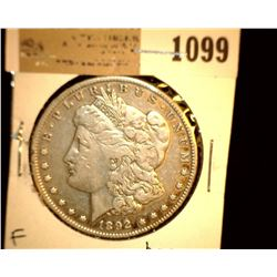 1099 _ 1892 S Morgan Silver Dollar, Fine. Baggy.