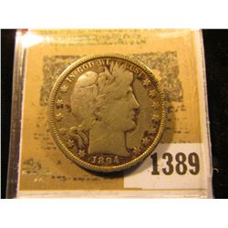 1389 _ 1894 O Barber Half Dollar, VG. Some weird stuff going on near the Date on this piece, buy as