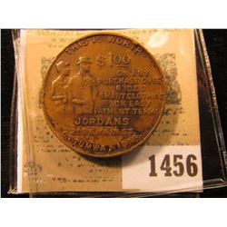 "1456 _ ""Jordan's 209 East Main St., Ottumwa, Iowa"" Token with Swastika reverse."