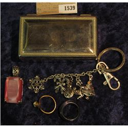 1539 _ Small Silvered Jewelry Box containing a couple of rings, a Pink faceted Pendant, & a Charm Ke