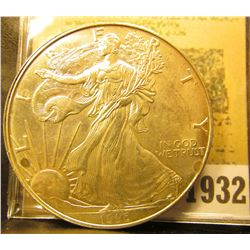 1932 _ 1996 American Eagle .999 Fine Silver Dollar, slight toning. One Ounce .999 Fine Silver. Scarc