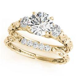0.89 CTW Certified VS/SI Diamond 3 Stone 2Pc Wedding Set 14K Yellow Gold - REF-119Y8K - 32050
