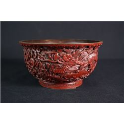 "A Large Carved Red Lacquer ""Dragon and Cloud"" Bowl."